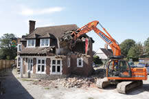 Rabbit Group demolition plant being used for house demolition
